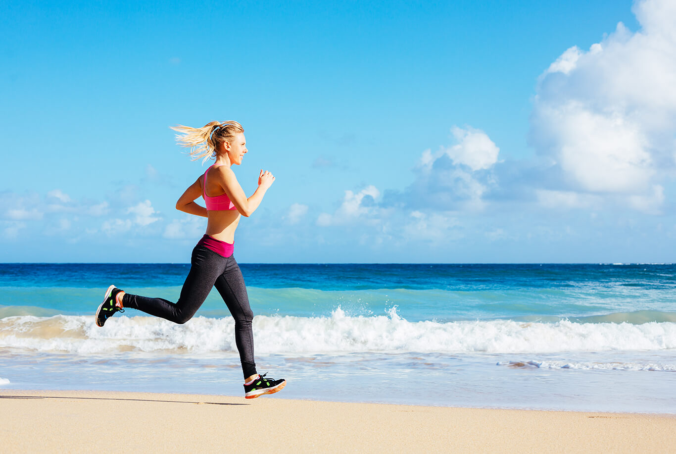 Athletic Fitness Woman Running on the Beach. Female Runner Jogging. Outdoor Workout. Fitness Concept.
