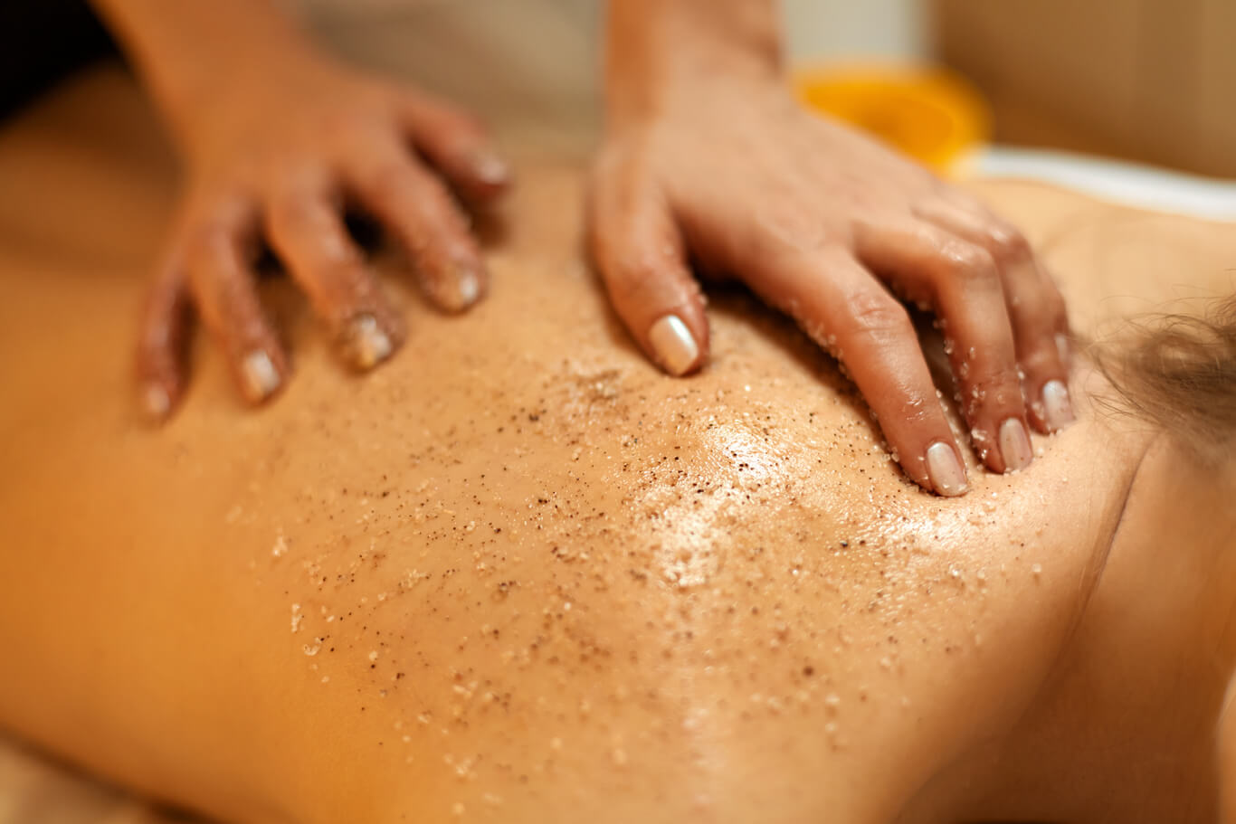 Body Scrub. Beautiful Blonde Gets a Salt Scrub Beauty Treatment in the spa Salon